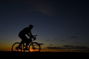 silhouette of cyclist on a trail during sunset