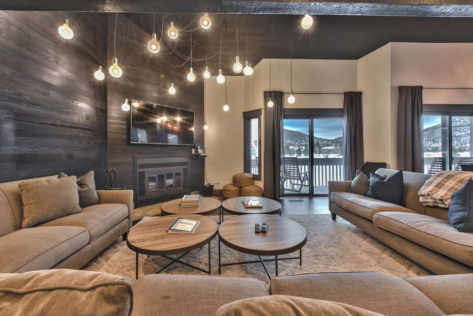 Large Living Room with Fireplace and TV in One of Our Rental Homes in Park City, Utah.
