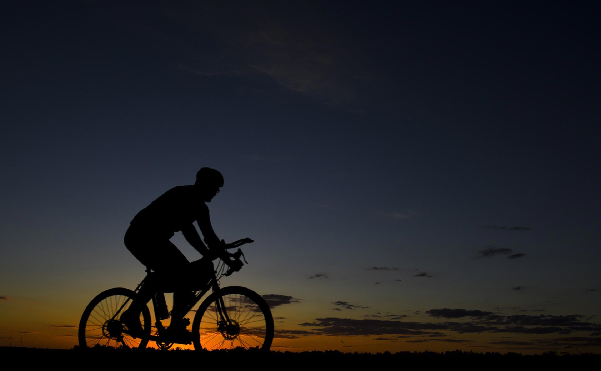 Cyclist Riding Around our Vacation Homes in Park City at Sunset.