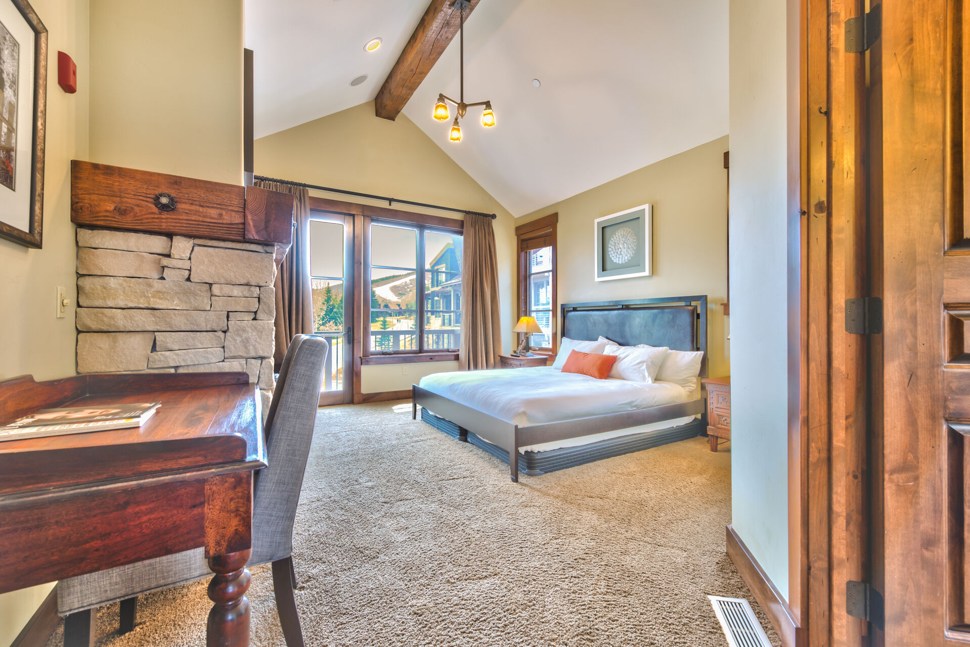 Large Bed and Desk in the Mountain View Bedroom in Our Park City Rentals.